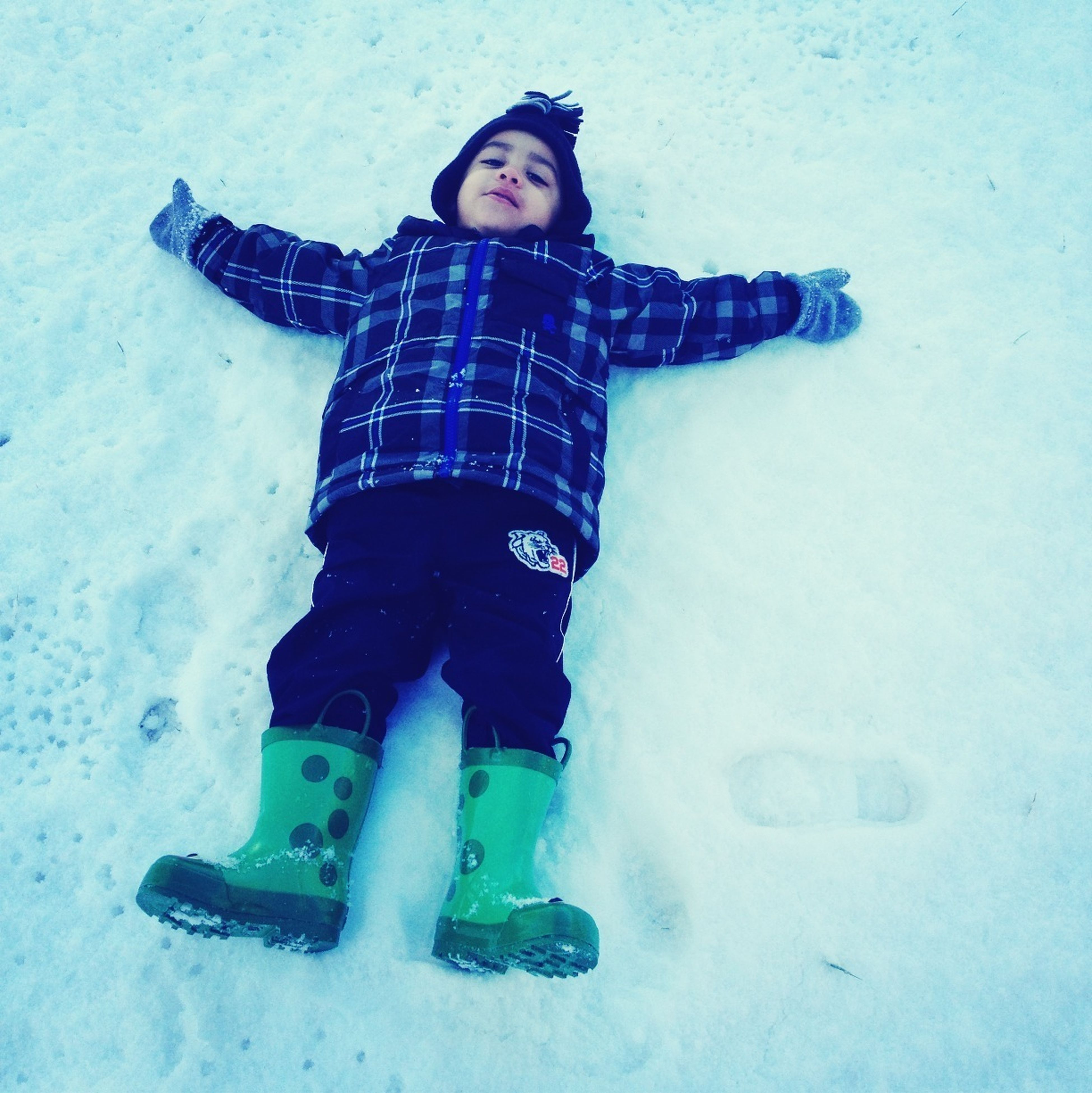 winter, snow, cold temperature, lifestyles, leisure activity, season, full length, warm clothing, person, weather, standing, casual clothing, high angle view, front view, childhood, looking at camera, portrait, covering