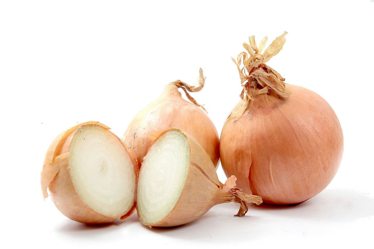 Close-Up Of Onions Isolated On White