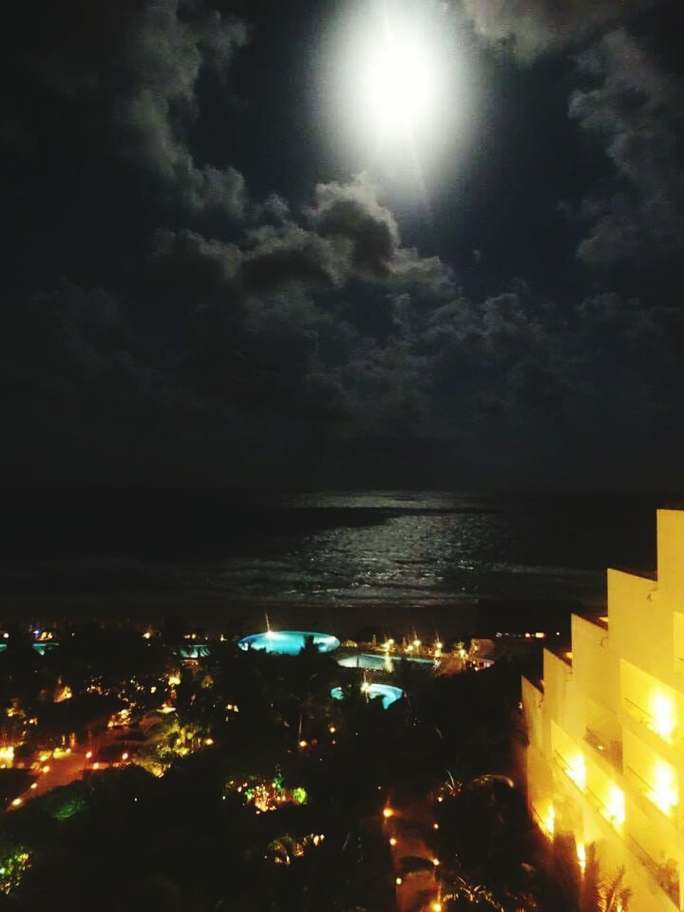 illuminated, night, sky, built structure, sea, outdoors, architecture, cloud - sky, building exterior, no people, water, nature, moon, city, beauty in nature, horizon over water