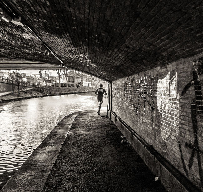 Canal Runner, Toulouse Built Structure Canal Canal Walks City Life Diminishing Perspective Leisure Activity Tunnel Unrecognizable Person Up Close Street Photography Walkway