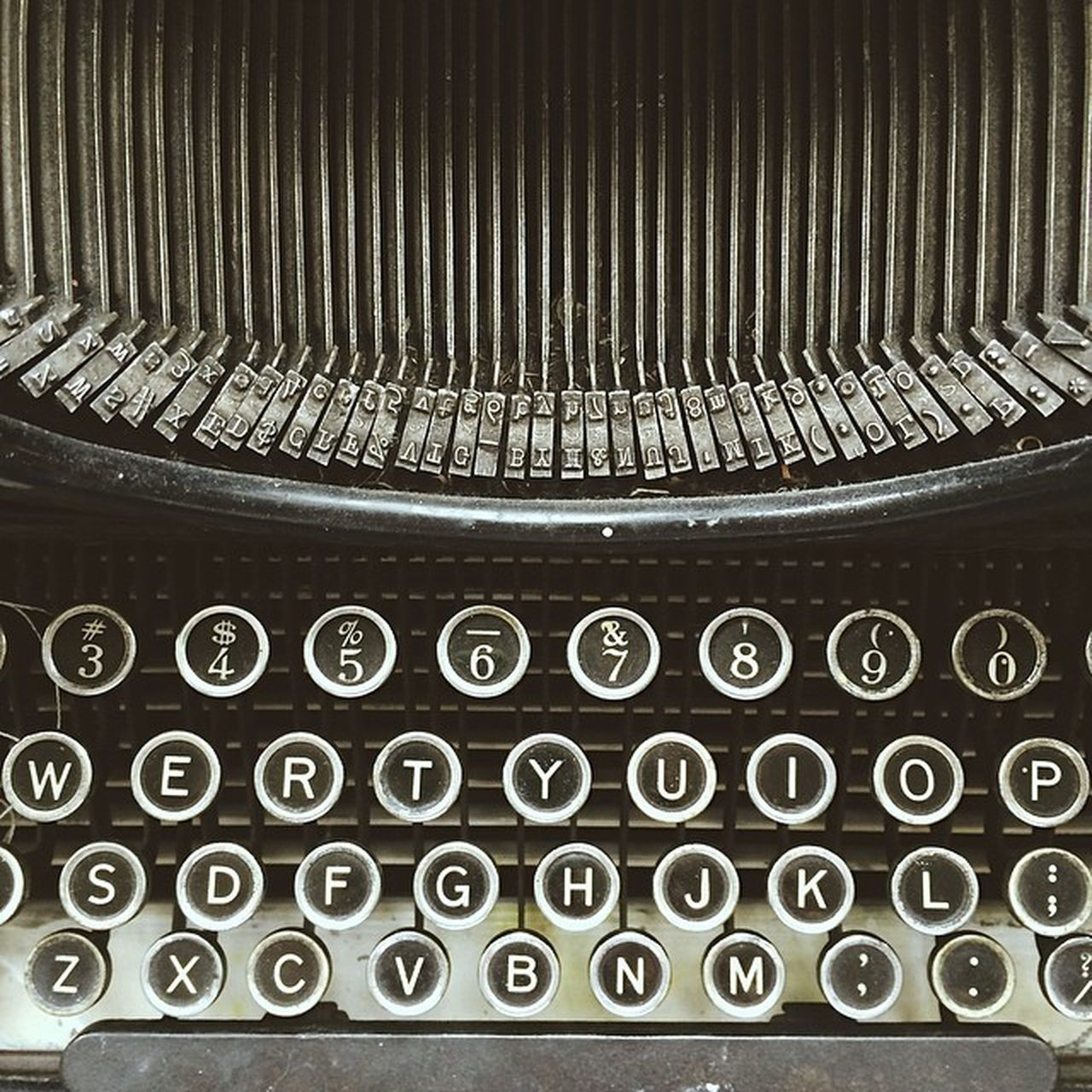 typewriter, old-fashioned, obsolete, old, retro styled, communication, antique, alphabet, text, technology, circle, number, close-up, indoors, pattern, black color, no people, backgrounds, textured, day, keyboard
