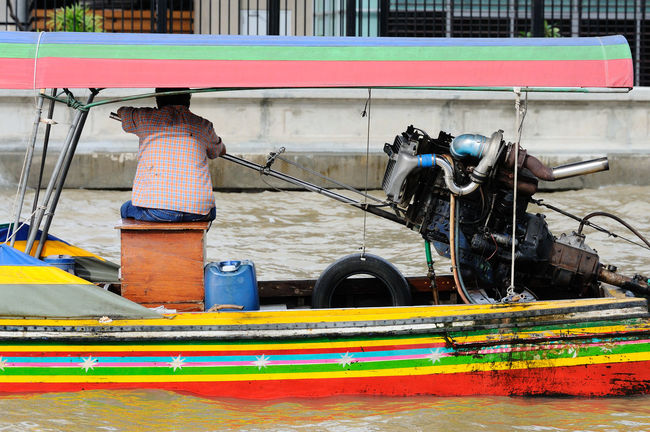 Bangkok Boat Boats Chao Phaya River Cropped Full Length Hobbies Holding Leisure Activity Lifestyles Men Mode Of Transport Occupation Part Of Real People Recreational Pursuit Sitting Thai Thailand Transportation Water