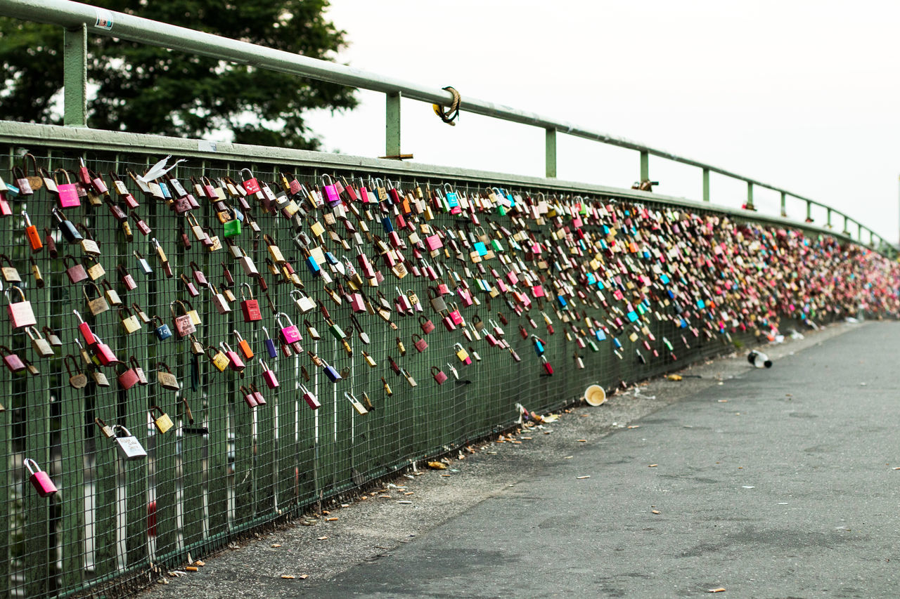 Abundance Bridge - Man Made Structure Connection Day Footbridge Hanging Hope Hope - Concept Large Group Of Objects Lock Love Love Lock Luck Metal No People Oath Outdoors Padlock Protection Railing River Safety Security Unity Variation
