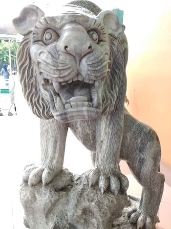 Statue of a mighty lion at Botani Square-Bogor Statues Statue In The City Statues/sculptures Statue Colection Statue Lion Sculpture Animal Photography Mascot Engraving Engraved In The Rock Engravings Engraved Stones Engravedstatue Art And Craft Animal Representation Sculpture Statue