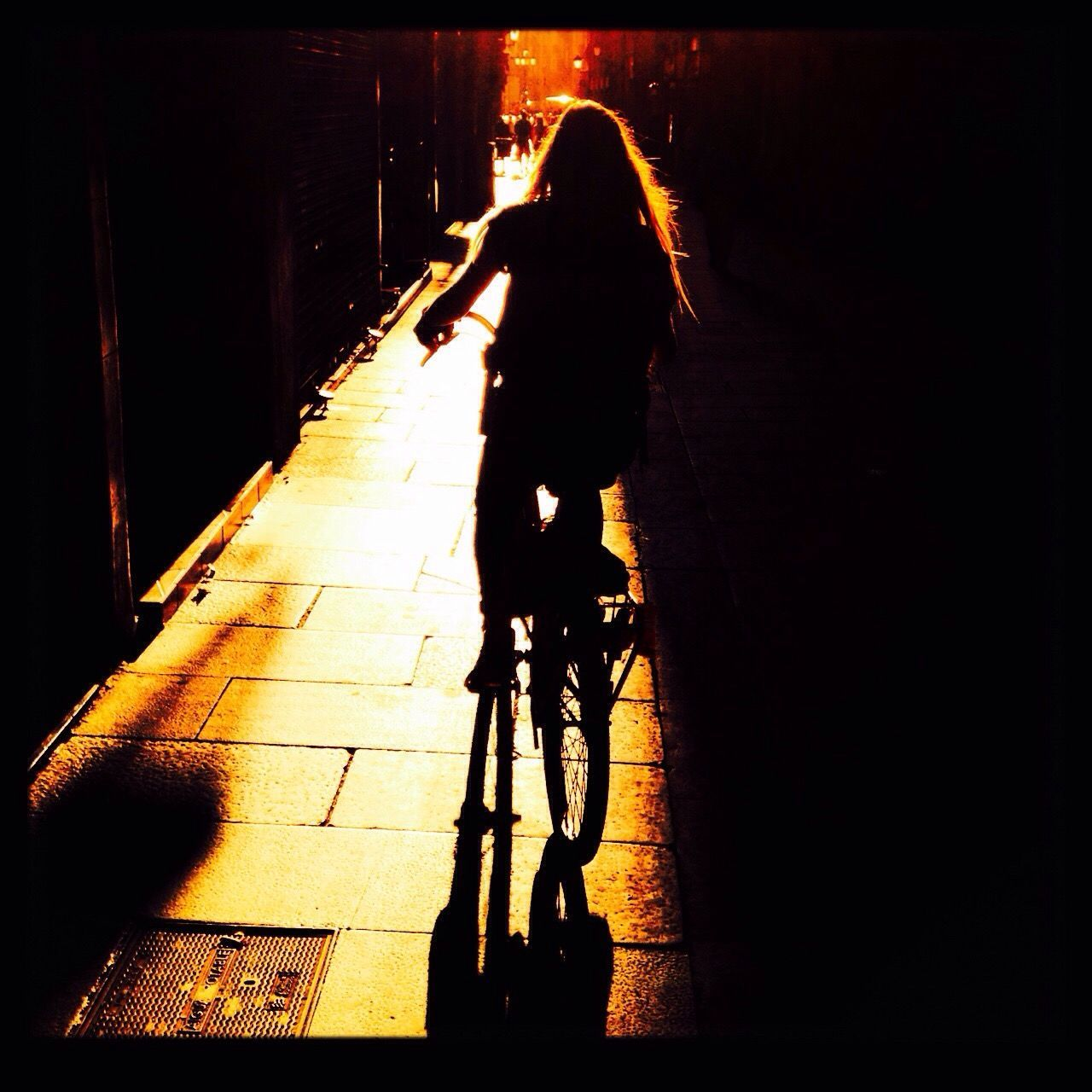 bicycle, real people, transportation, full length, one person, cycling, riding, mode of transport, sunlight, lifestyles, land vehicle, rear view, leisure activity, shadow, women, outdoors, day, men, wheelchair, people