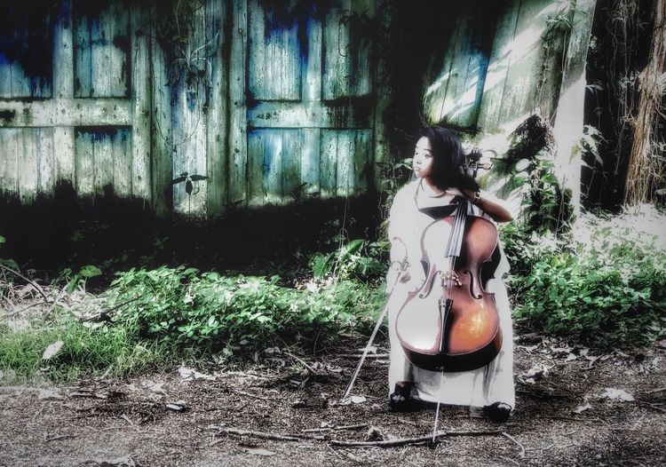 The sounds of strings at abandoned places. Musician Music Cello Cellist One Person Young Adult Outdoors Musical Instrument Architecture Music Outside Abandoned Places Musicians At Abandoned Places Musicians Around The World🎶 Women In Nature Woman In White Dress Woman In Jungle Lost In The Landscape Second Acts One Step Forward