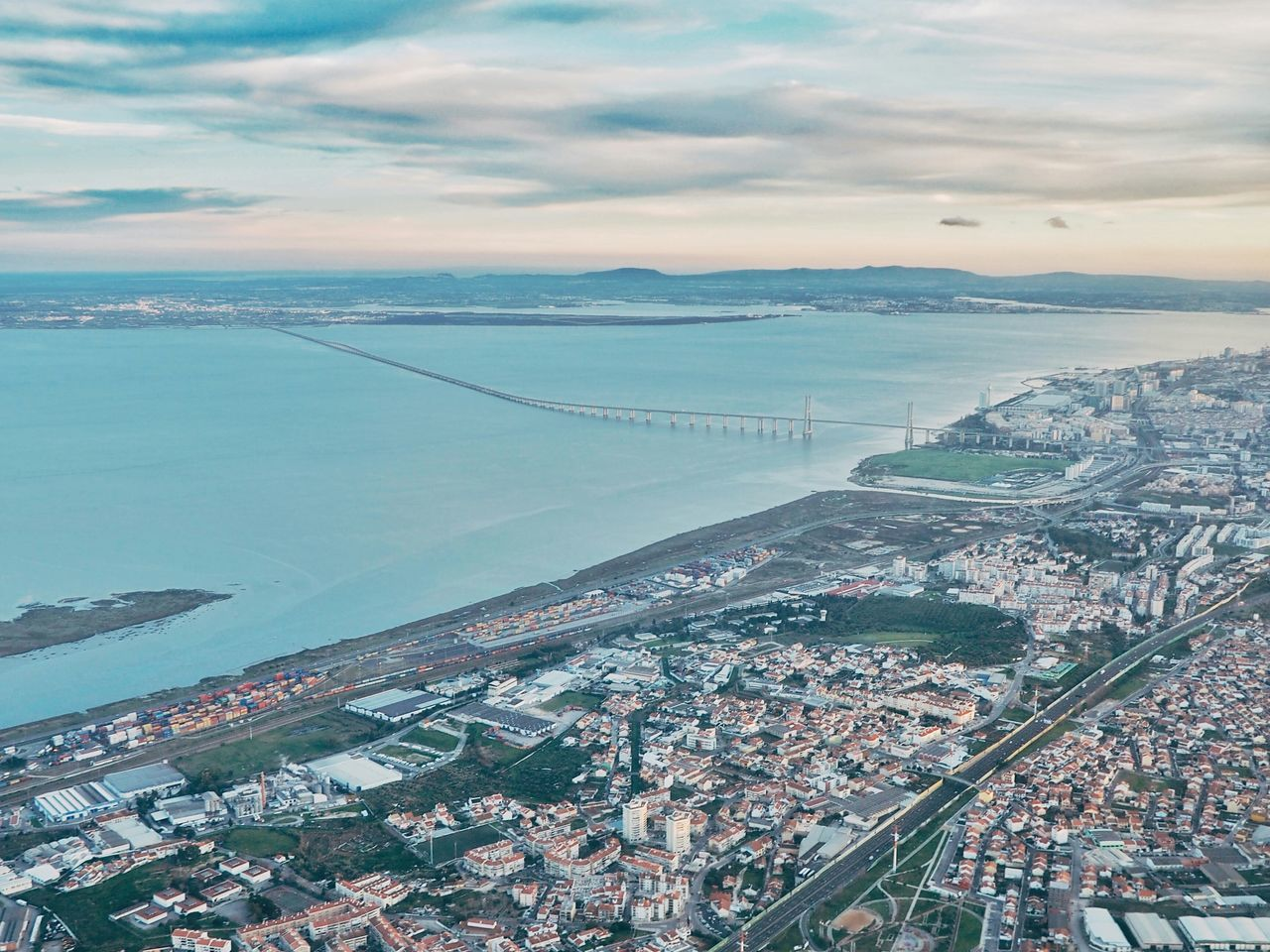 Business Finance And Industry Cityscape Sea Aerial View City Outdoors Sky No People Cloud - Sky Sunset Beach Architecture Day Horizon Over Water Skyscraper Blue Water Travel Destinations Scenics Building Exterior Airplaneview Lisbon Portugal Lisbon View Scenic View Neighborhood Map