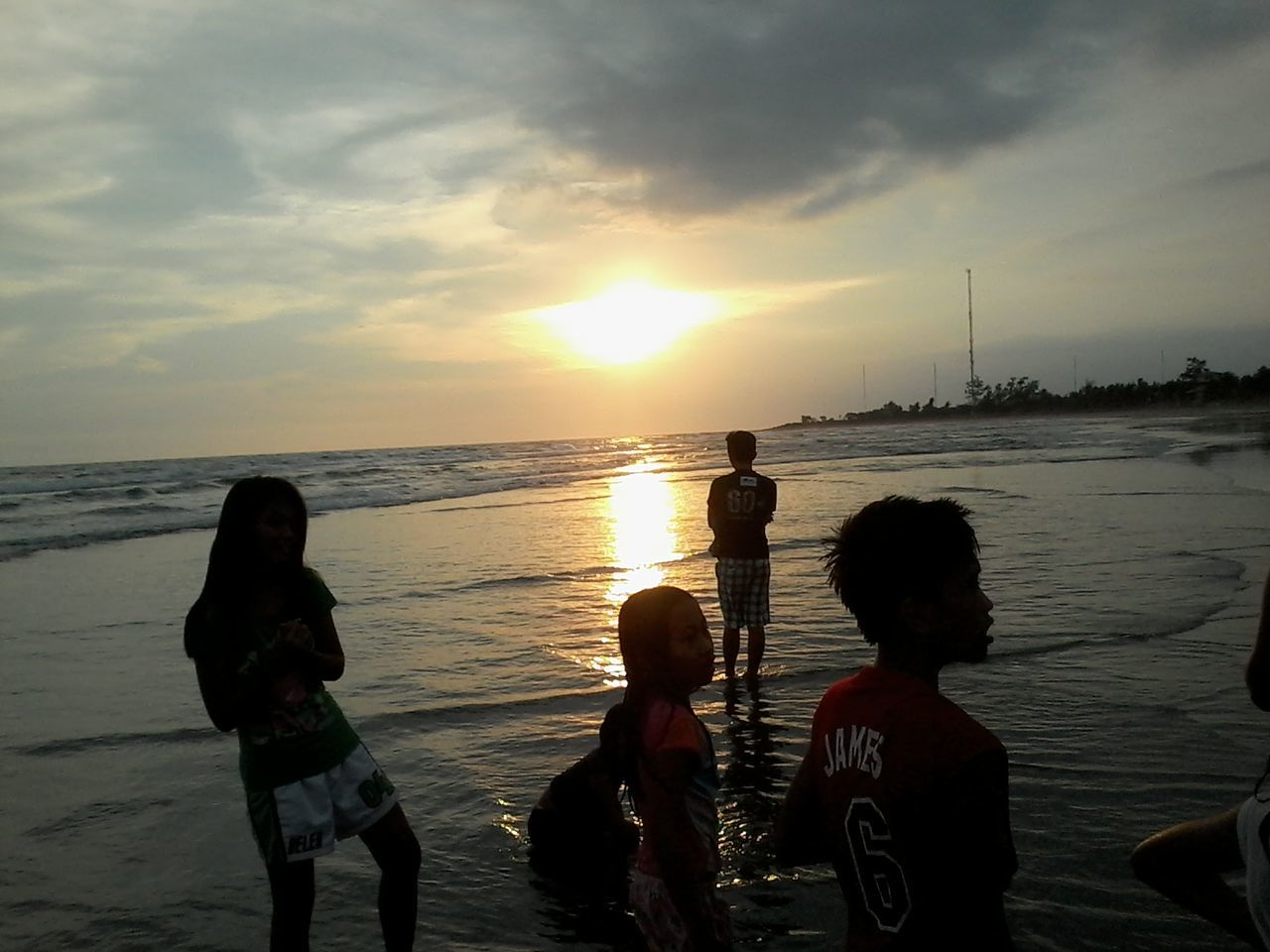 Sunset Sea Beach Water Boys Child Travel Destinations Outdoors People Silhouette Nature Sun Adult Sky Day Play Scenery Twilight