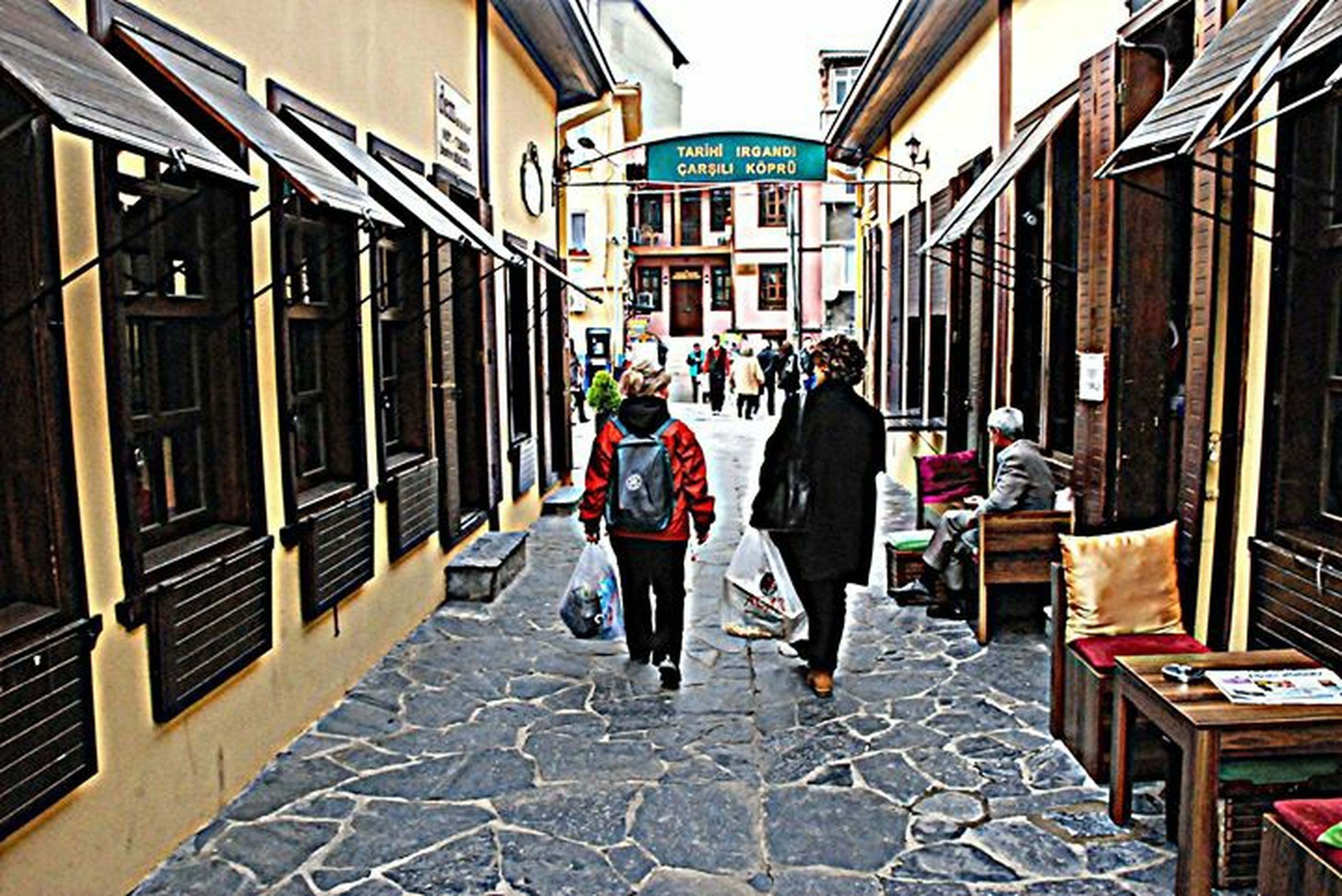 building exterior, architecture, built structure, city, men, walking, rear view, street, full length, city life, lifestyles, person, cobblestone, the way forward, residential building, residential structure, building, sidewalk