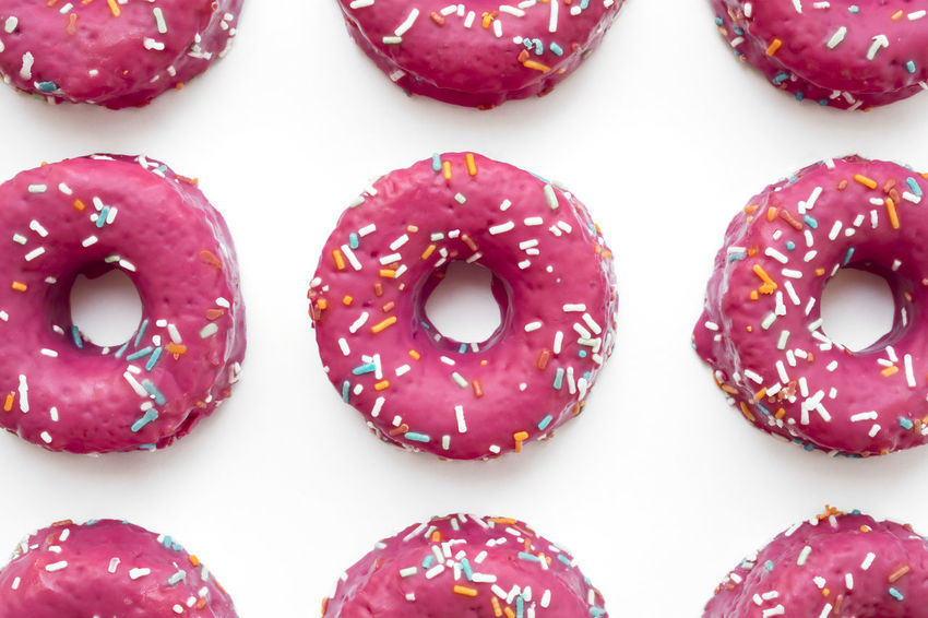 Group of ordered glazed pink donuts in white isolated background Baked Goods Donuts Backgrounds Bakery Doughnuts Food Food And Drink Freshness Pastry Pastryporn Ready-to-eat Sweet Food Temptation Unhealthy Eating Wallpaper White Background White Isolated