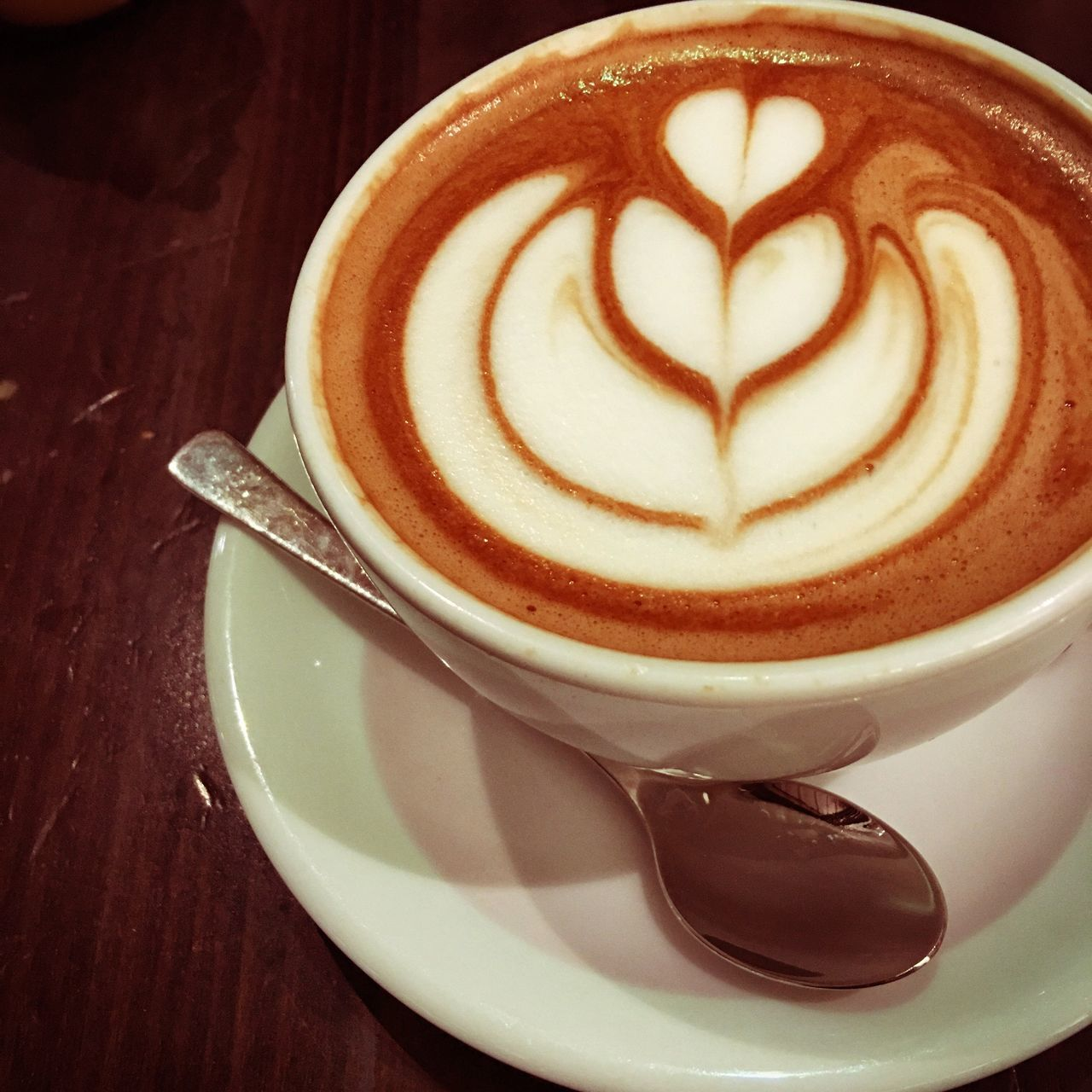 coffee cup, coffee - drink, frothy drink, drink, cappuccino, froth art, refreshment, food and drink, saucer, table, cup, latte, creativity, shape, close-up, freshness, foam, heart shape, indoors, no people, serving size, thick, day