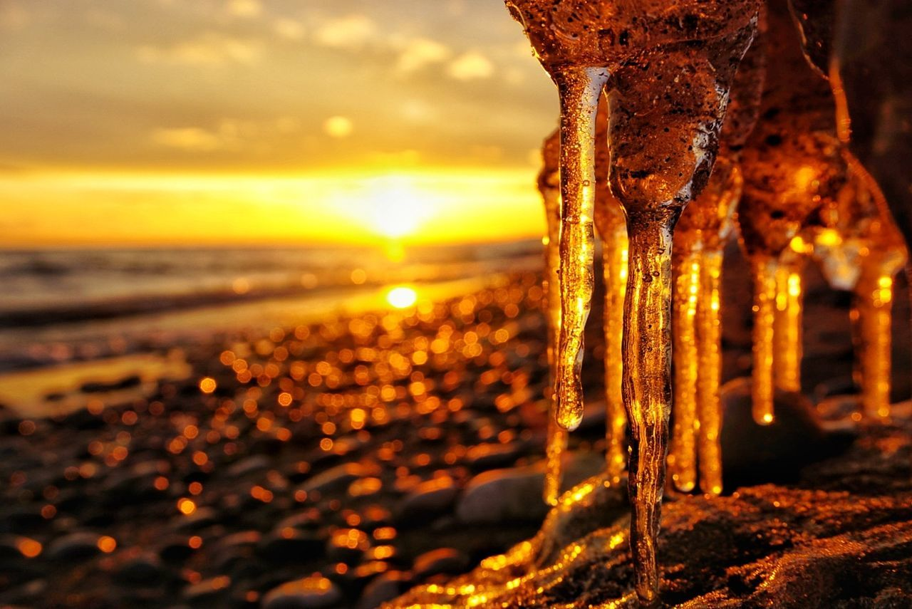 A cold winters sunset over Lake Ontario. Sunset Water Beauty In Nature Sea Nature Beach Sky No People Outdoors Gold Colored Scenics Close-up Freeze Canadian Winter Freezingweather Freezing Canadiannature Beauty In Nature Frozen Nature Cold Temperature Winter