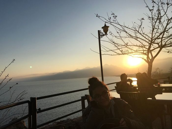 Sunset Sea Nature Water Real People Togetherness Beauty In Nature Outdoors Scenics Sky Women Men Lifestyles Tree Day People