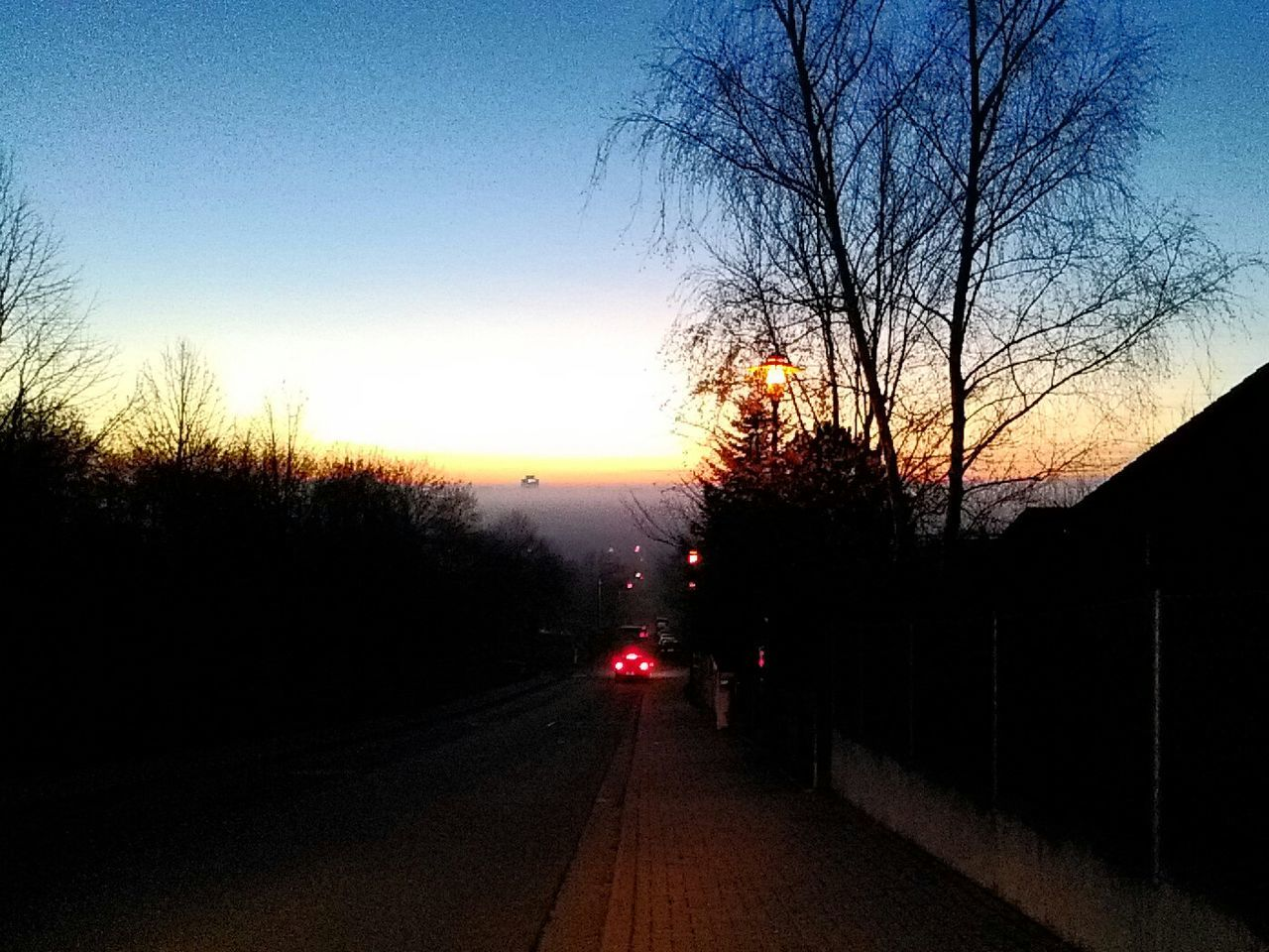 bare tree, tree, sunset, sky, no people, the way forward, car, road, outdoors, branch, clear sky, nature, beauty in nature, day