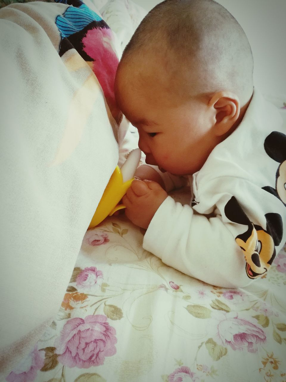 baby, babyhood, sleeping, newborn, innocence, indoors, childhood, cute, fragility, toddler, real people, bed, new life, holding, eyes closed, love, pacifier, sucking, babies only, lying down, two people, close-up, togetherness, full length, bedroom, day, people