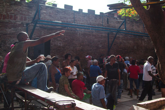 Casual Clothing Celebration Celebration In Cuba City City Life Cuba Dance In Cuba Day Enjoyment Fun Group Of People Large Group Of People Leisure Activity Lifestyles Medium Group Of People Mejunje Mixed Age Range Outdoors Reach Out Santa Clara