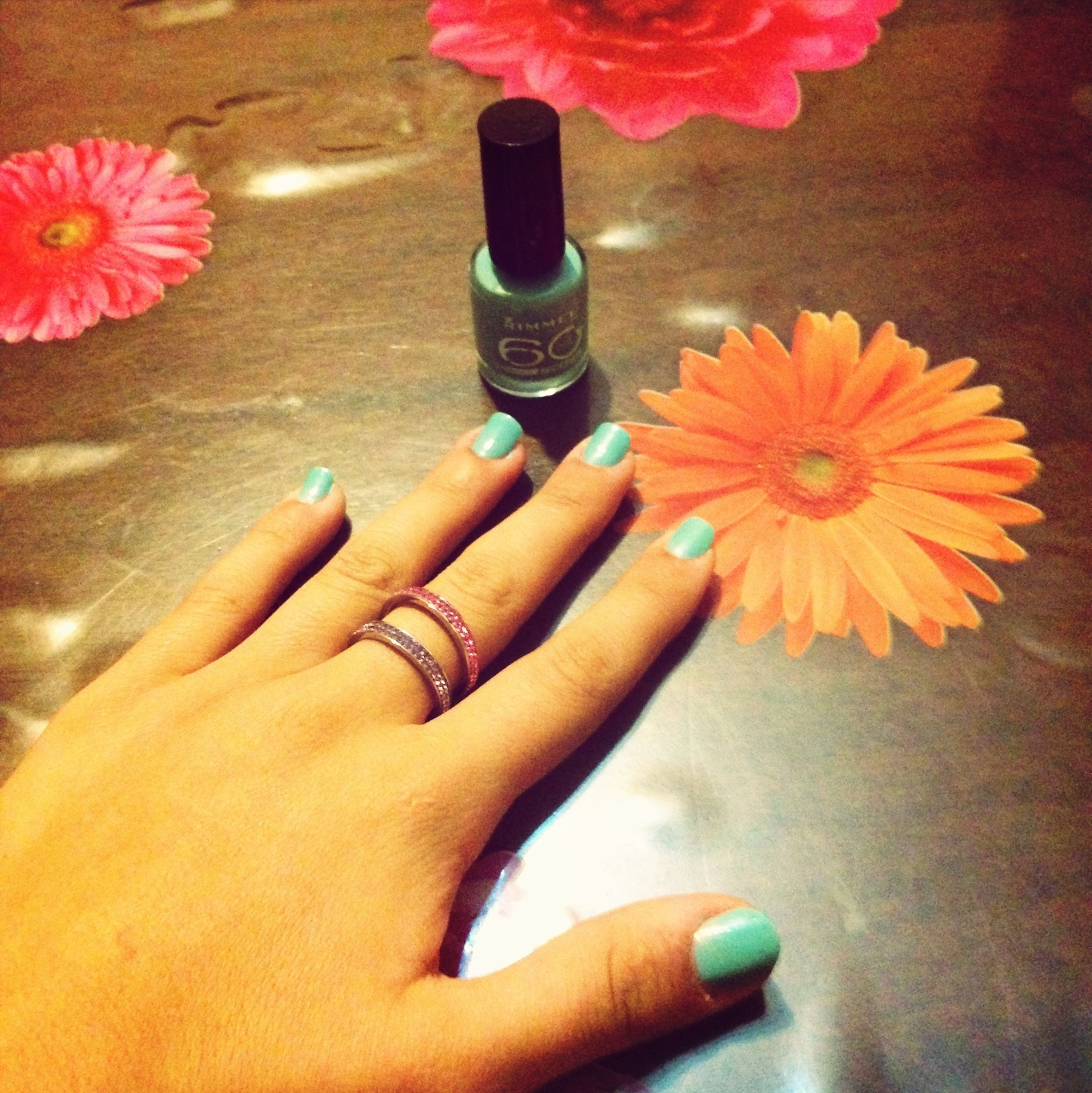 person, indoors, part of, lifestyles, flower, low section, holding, personal perspective, human finger, high angle view, cropped, leisure activity, human foot, nail polish, close-up