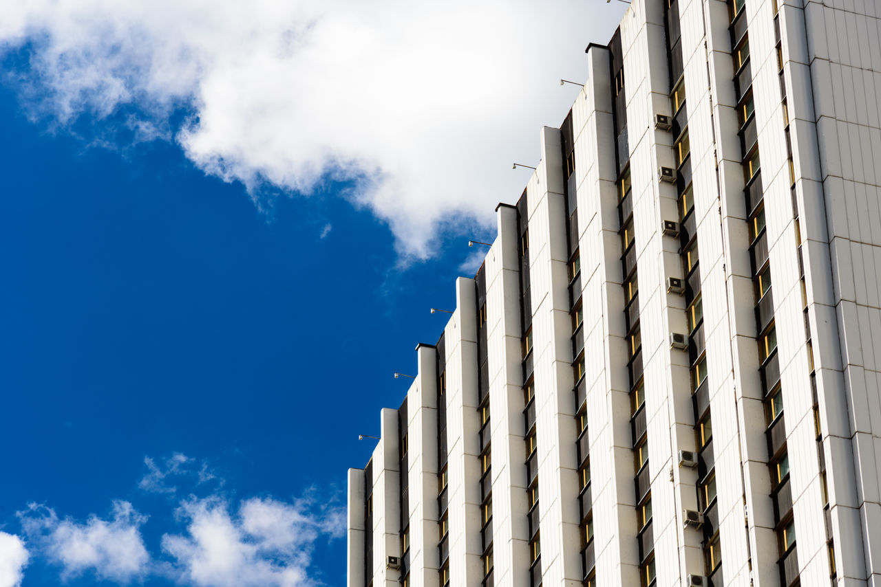 Architectural Feature Architecture Arrangement Blue Building Exterior Building Story City Life Cloud Cloud - Sky Day Destination Facade Building High Section In A Row Low Angle View Modern Modern Architecture No People Office Building Order Outdoors Repetition Sky Tall Travel