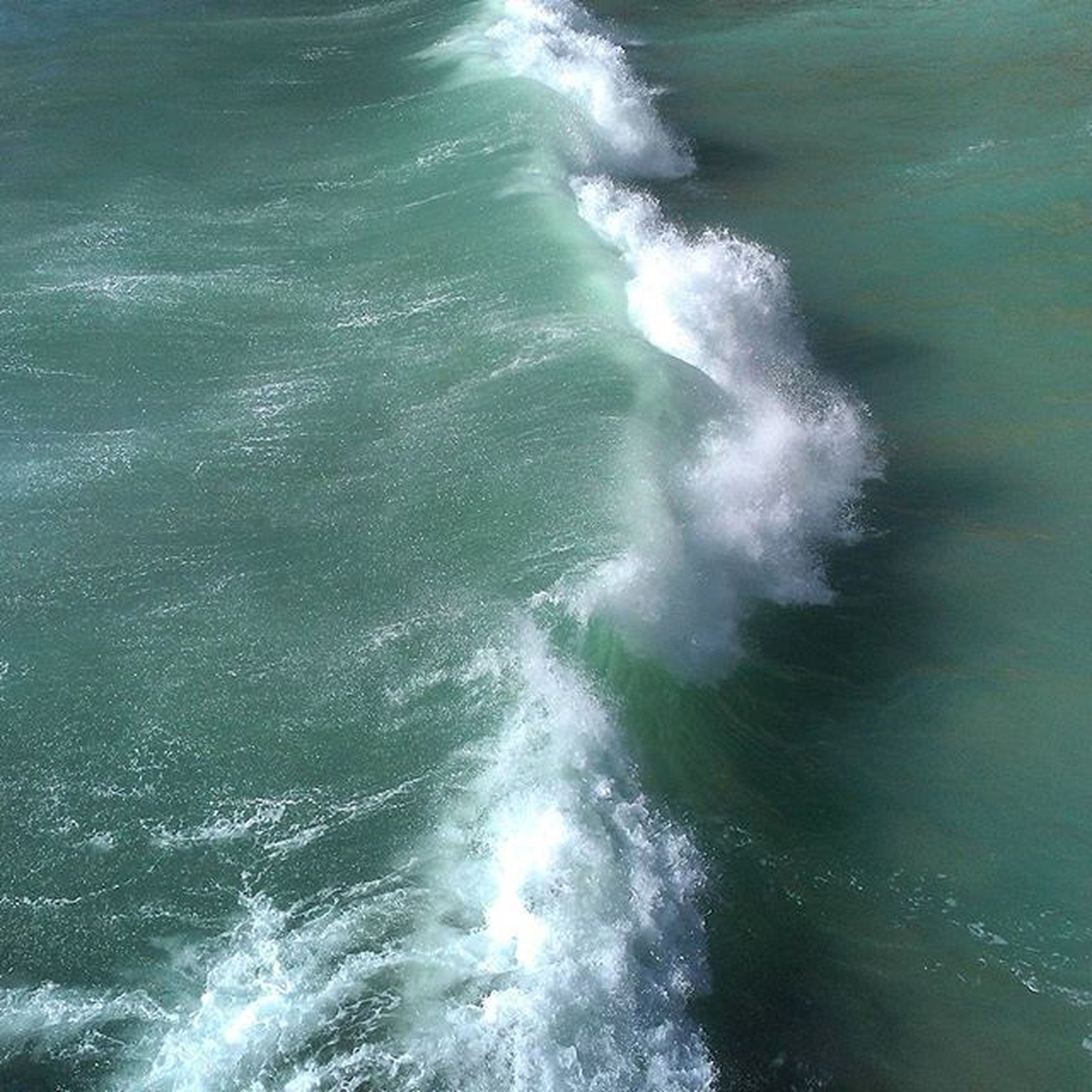 water, sea, waterfront, wave, motion, rippled, surf, splashing, high angle view, nature, beauty in nature, power in nature, day, outdoors, no people, sunlight, scenics, tranquility, rock - object, idyllic