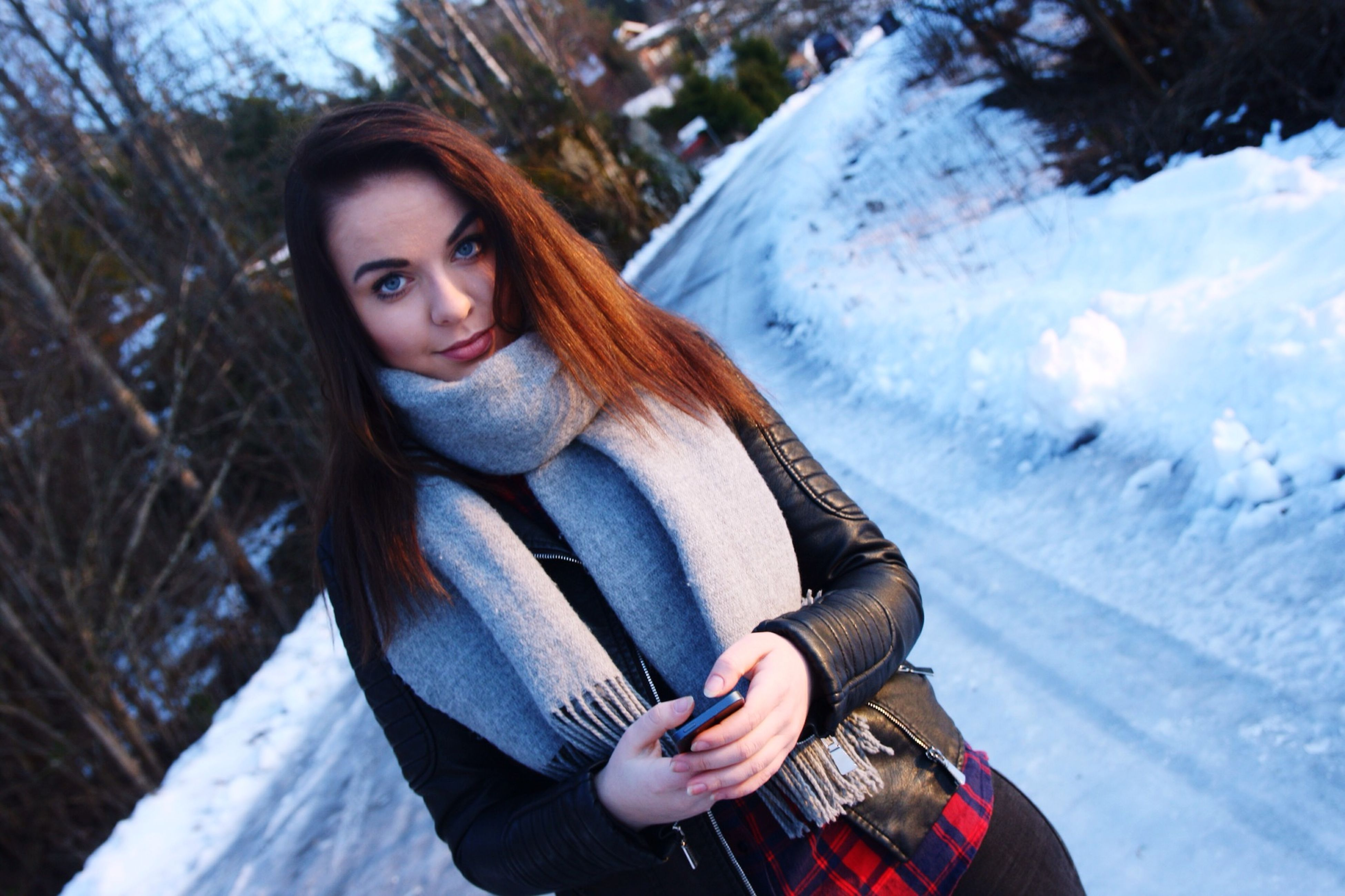 person, portrait, looking at camera, lifestyles, leisure activity, young adult, winter, casual clothing, smiling, snow, cold temperature, front view, happiness, young women, three quarter length, waist up, toothy smile, full length