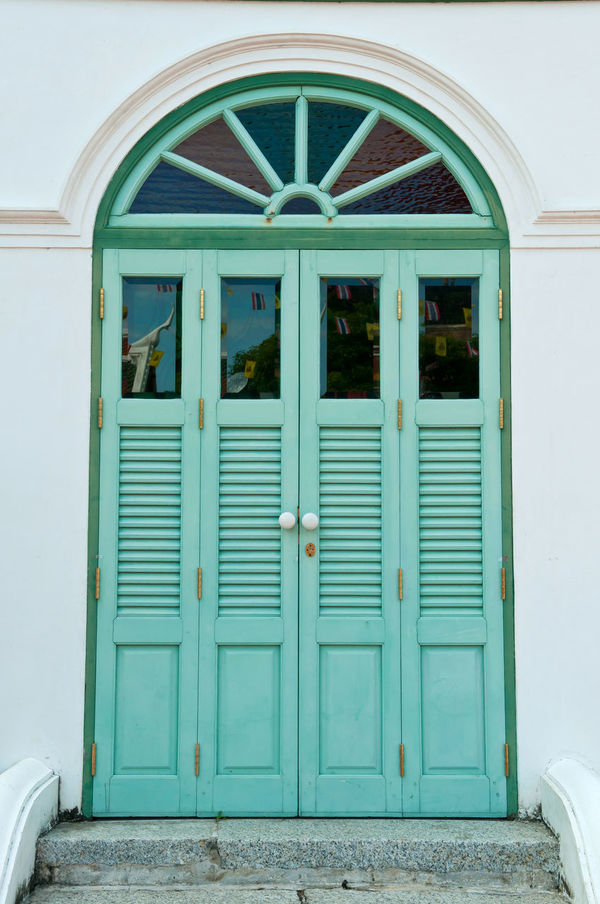 The antique door was newly painted in turquoise blue. Aged Antique Architecture Bolts Closed Door Decoration Door Doorknob Hasp Keyhole Newly No People Oriental Style Outdoors Painted Retro-styled Turquoise Blue Vintage Wooden