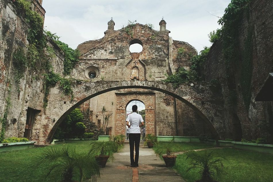 Spanish title: Noli me tangere (Touch me not) Built Structure Architecture Arch Rear View History Footpath Standing Sky Building Exterior The Past Day Outdoors Formal Garden Archway Ruins Architecture Church Eyeem Philippines EyeEm EyeEm Best Shots Eyeem Architecture Filipina Nursing Student Spanish