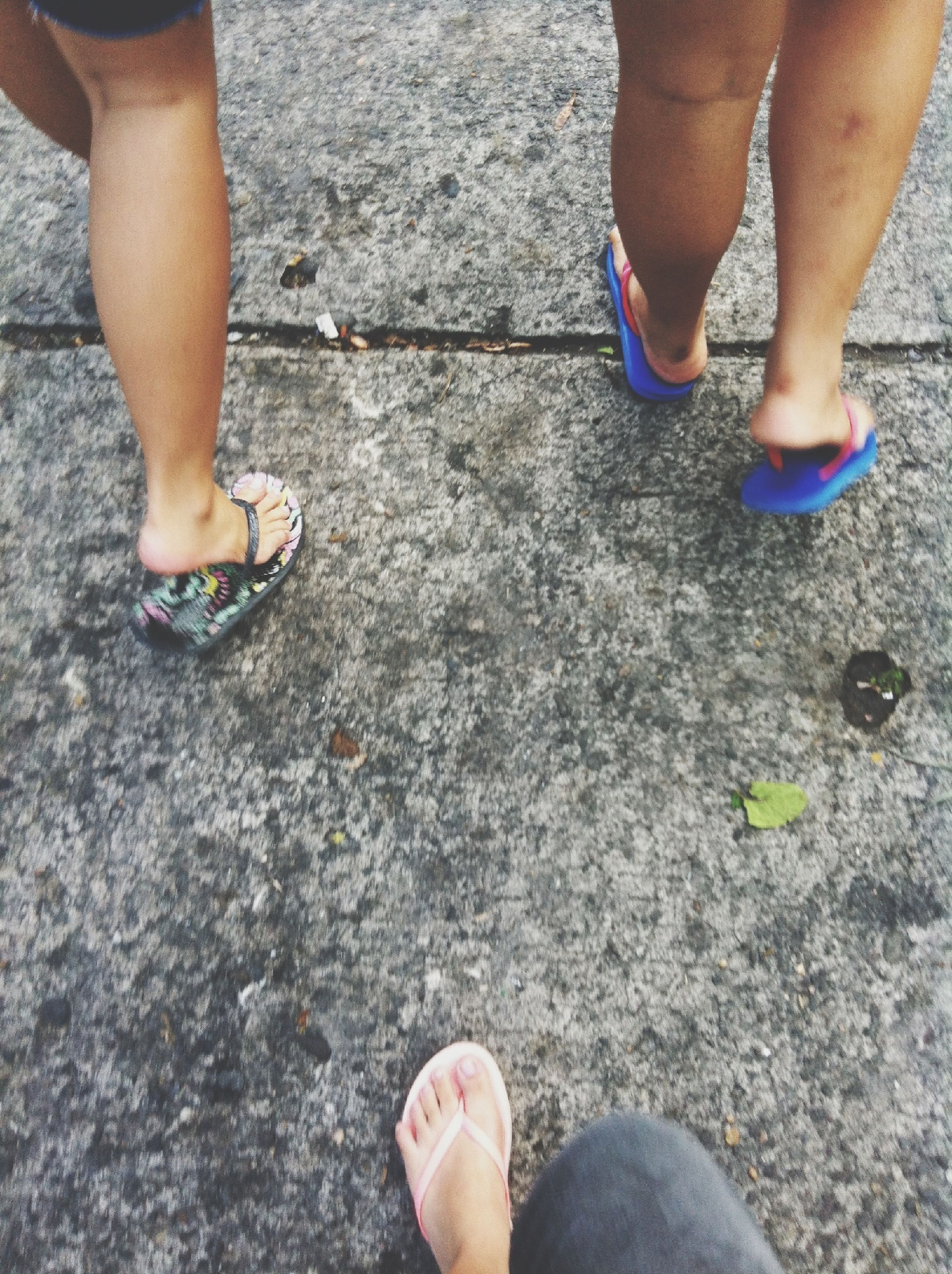 low section, person, human foot, shoe, standing, lifestyles, leisure activity, footwear, personal perspective, men, high angle view, togetherness, barefoot, part of, street