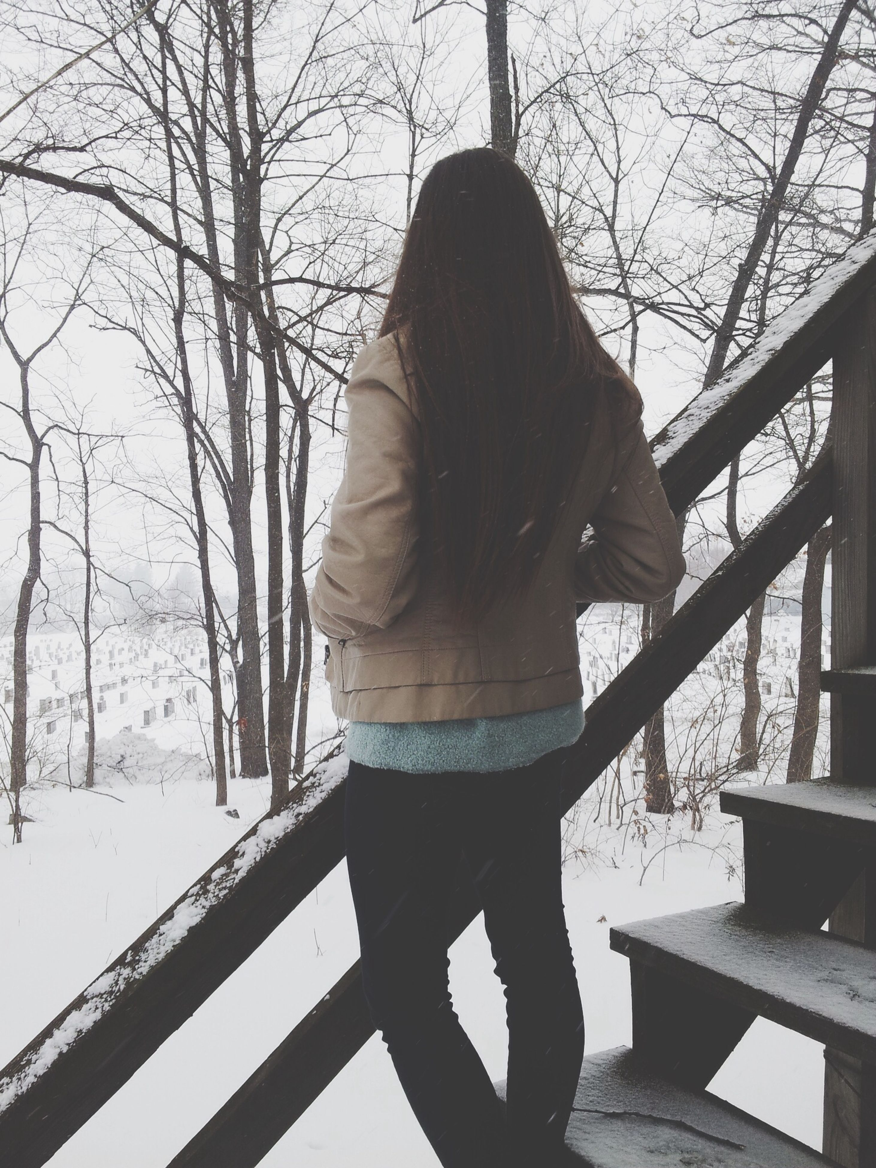rear view, full length, lifestyles, standing, winter, tree, leisure activity, snow, railing, casual clothing, cold temperature, warm clothing, season, person, three quarter length, day, bare tree, walking