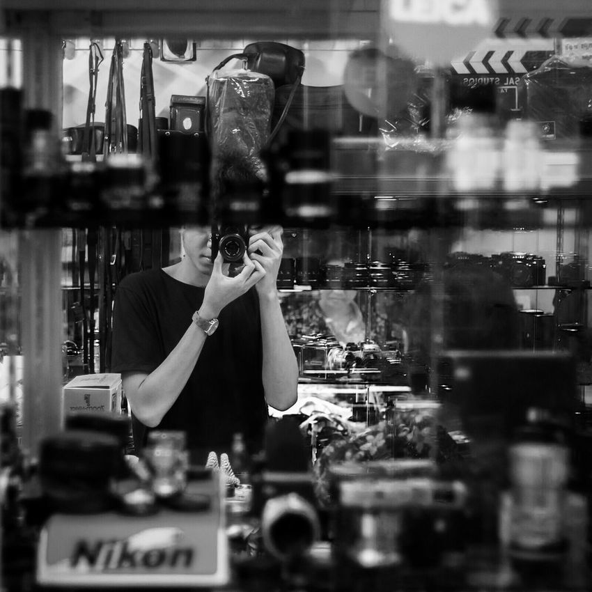 EyeEm Selects Retail  Store Reflection Store Window Retail Display Real People For Sale Consumerism Photography Themes Choice Outdoors One Person Photographing Fashion Women Building Exterior Day City Freshness Supermarket