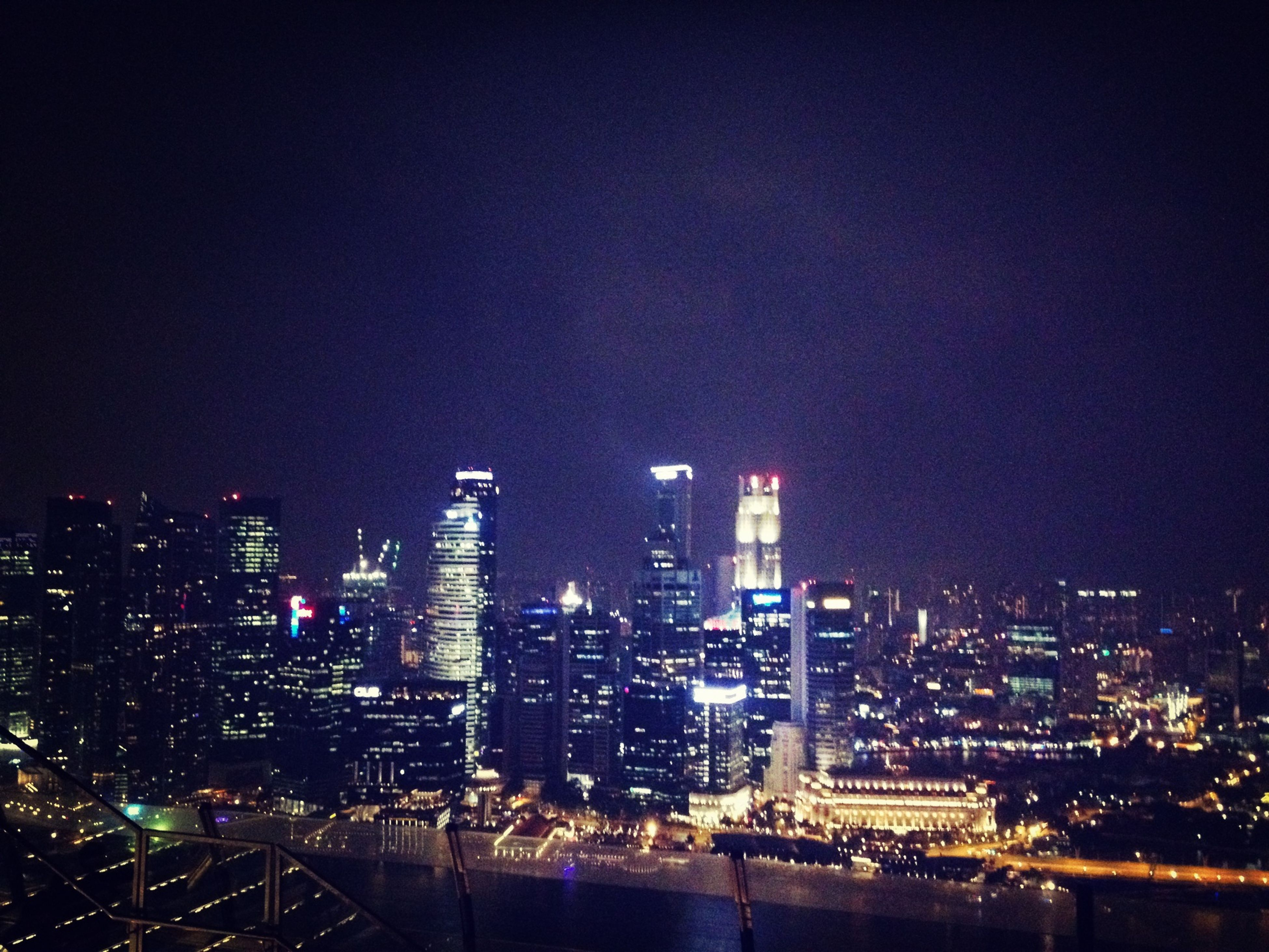city, cityscape, night, illuminated, building exterior, architecture, built structure, skyscraper, crowded, modern, urban skyline, office building, clear sky, water, copy space, tall - high, tower, river, high angle view, residential building
