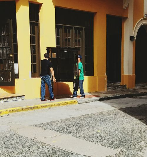 Architecture Standing Men Real People Lifestyles City Light And Shadow Urban Exploration Architectural Detail San Juan PR Popular City Life Yellow