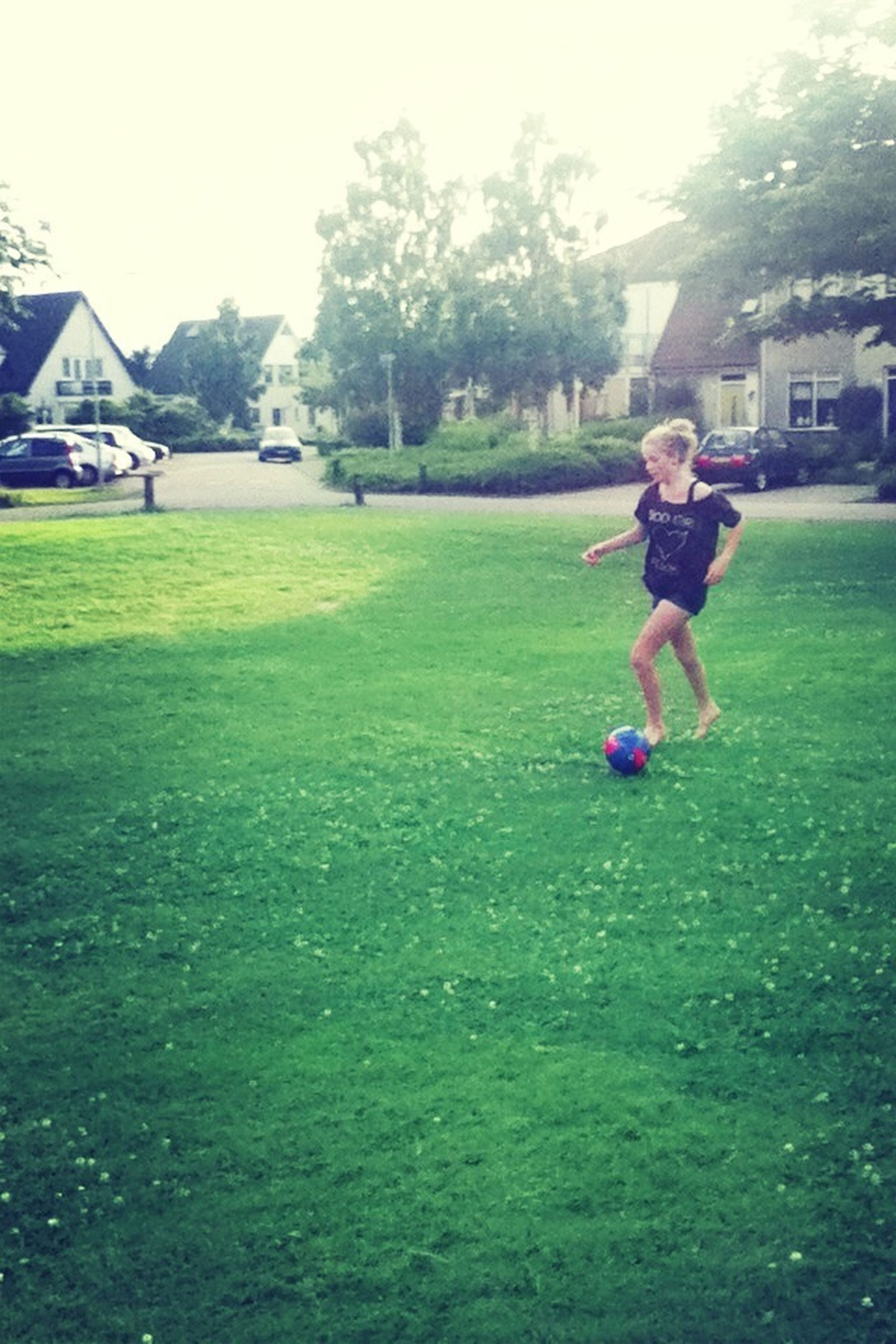 grass, lifestyles, leisure activity, childhood, full length, casual clothing, girls, elementary age, playing, boys, person, park - man made space, enjoyment, fun, playful, field, tree, grassy