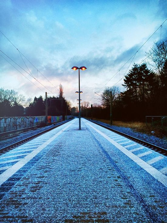 frozen Street Light Road The Way Forward Transportation Blue Sky Long Straight Cable Surface Level Diminishing Perspective Tranquil Scene Day Lamp Post Cloud - Sky Outdoors Solitude Tranquility No People Scenics Winter Is Coming Long Goodbye