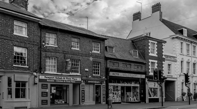 Shops, High Street, Newport Pagnell, Buckinghamshire High Street Newport Pagnell Buckinghamshire Black And White Monochrome Architecture Shops