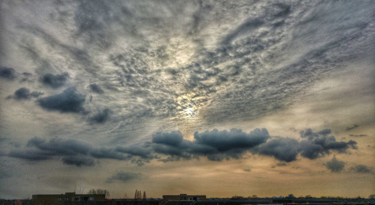 cloud - sky, sky, cloud, dramatic sky, atmospheric mood, cloudscape, storm cloud, no people, weather, beauty in nature, nature, sunset, scenics, outdoors, tranquility, architecture, building exterior, built structure, silhouette, low angle view, day, thunderstorm, city, cityscape