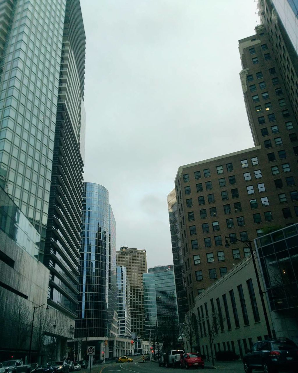architecture, city, building exterior, skyscraper, built structure, modern, tall - high, city life, tower, low angle view, tall, downtown district, outdoors, cityscape, sky, day, travel destinations, growth, no people, office park