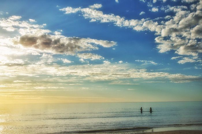 Spring fun in the sun Sea Water Beach Sky Horizon Over Water Scenics Beauty In Nature Cloud - Sky Nature Real People Tranquil Scene Tranquility Two People Leisure Activity Outdoors Sand Silhouette Men Sunset Vacations