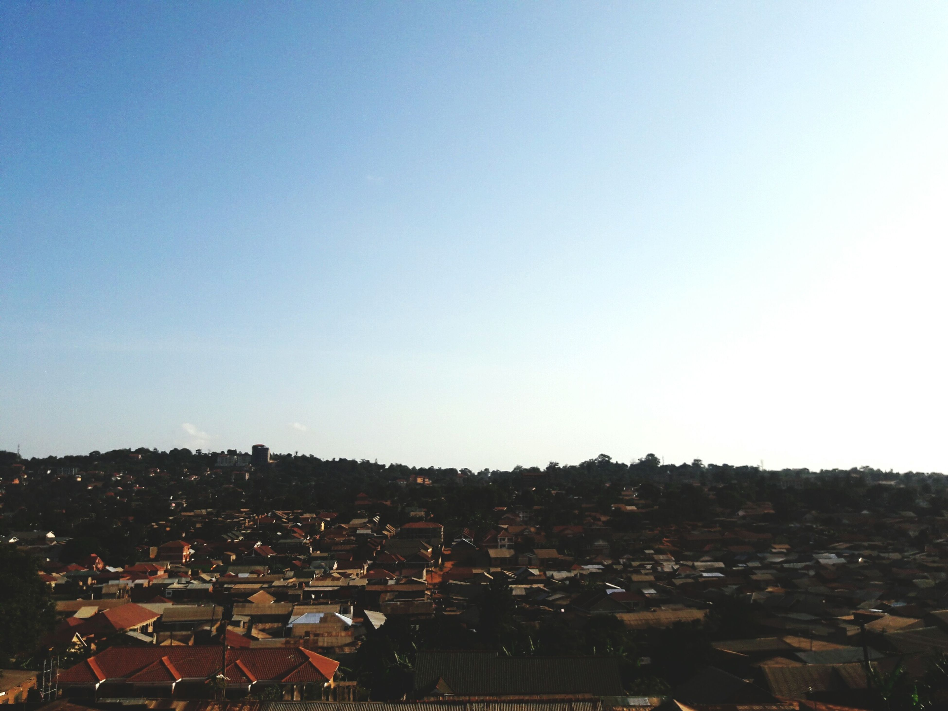 clear sky, built structure, landscape, blue, cityscape, city, residential district, outdoors, sky, no people, nature, horizon over land, day, scenics, tranquility, beauty in nature, tranquil scene, vignette