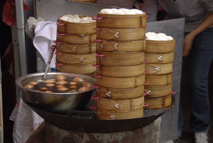 Bamboo Steamers Chinese Food Teaeggs Barrel Basket China Chinese Dumplings Close-up Container Day Dim Sum Food Food And Drink For Sale Freshness Indoors  Large Group Of Objects Market One Person Real People Streetfood