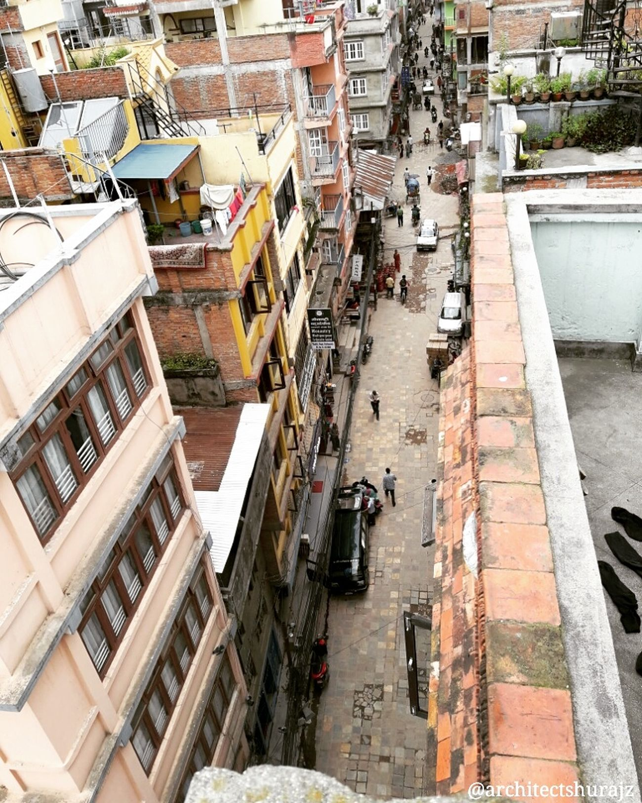 Narrow streets of core kathmandu city was built for pedestrian purpose during Malla period. Now its overhaul with motorbikes, cars and vehicles. MyCity❤️ Showcase August Architecturelovers Urban Landscape Urban Exploration Kathmandu Nepal Kathmandu, Nepal NepalNow Architecturephotography Architecture Travel Archidaily Archilovers Street Photography Architecture - Eye On Detail ARCHITECT Rooftop Pivotal Ideas A Bird's Eye View Embrace Urban Life Flying High