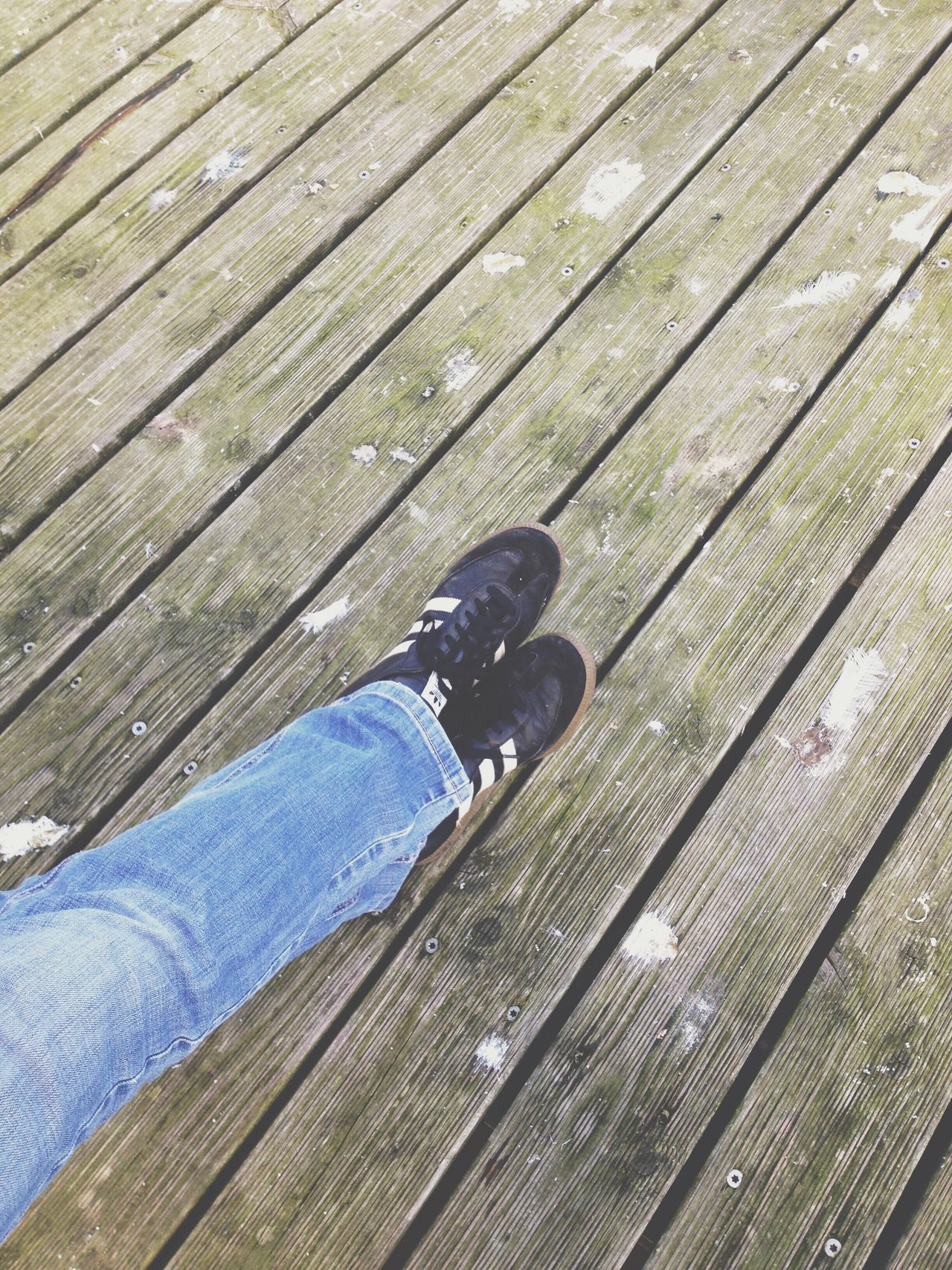 TCPM Calm Resting Relaxing Relaxing Moments Human Leg Wood - Material Low Section Shoe Human Body Part One Person High Angle View Real People Jeans Wood Paneling Leisure Activity Lifestyles Outdoors One Man Only People Photography Out Of The Box Place Of Heart
