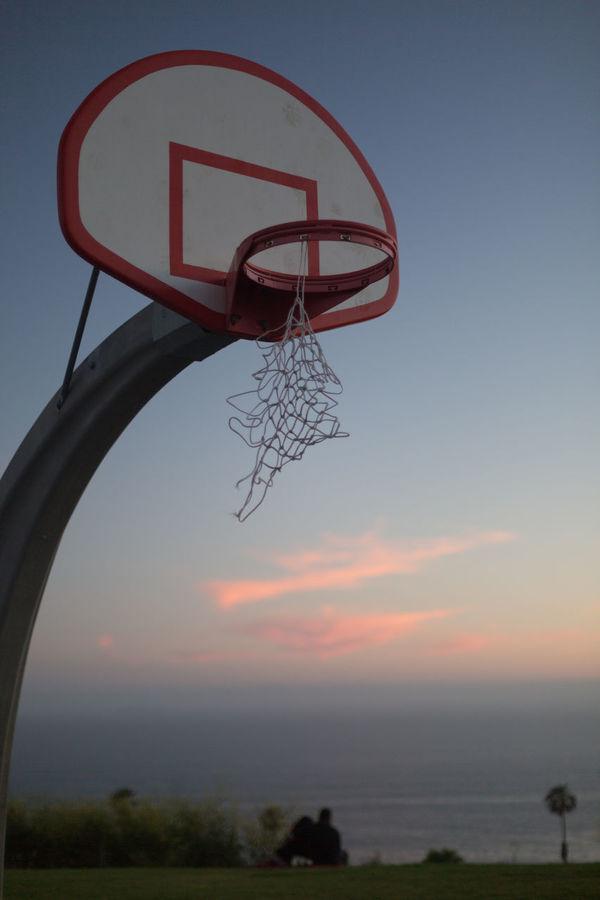 Hoop at twilight Basketball Basketball Court Clouds Getting Dark Hillside Hoop Net Ocean View Orange Glow In The Sky Outdoors Pink Clouds Pink Glow In The Sky Shallow Depth Of Field Sky Twilight