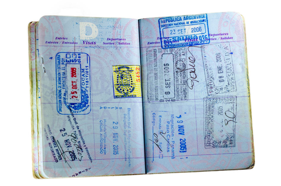 Inside pages and stamps of a well used American passport isolated on white America Background Business Country Customs Destination Document Id Identification Identity Immigration International Official Pass Passport Security Stamp Tourism Travel USA Vacation Visa White World ınternational