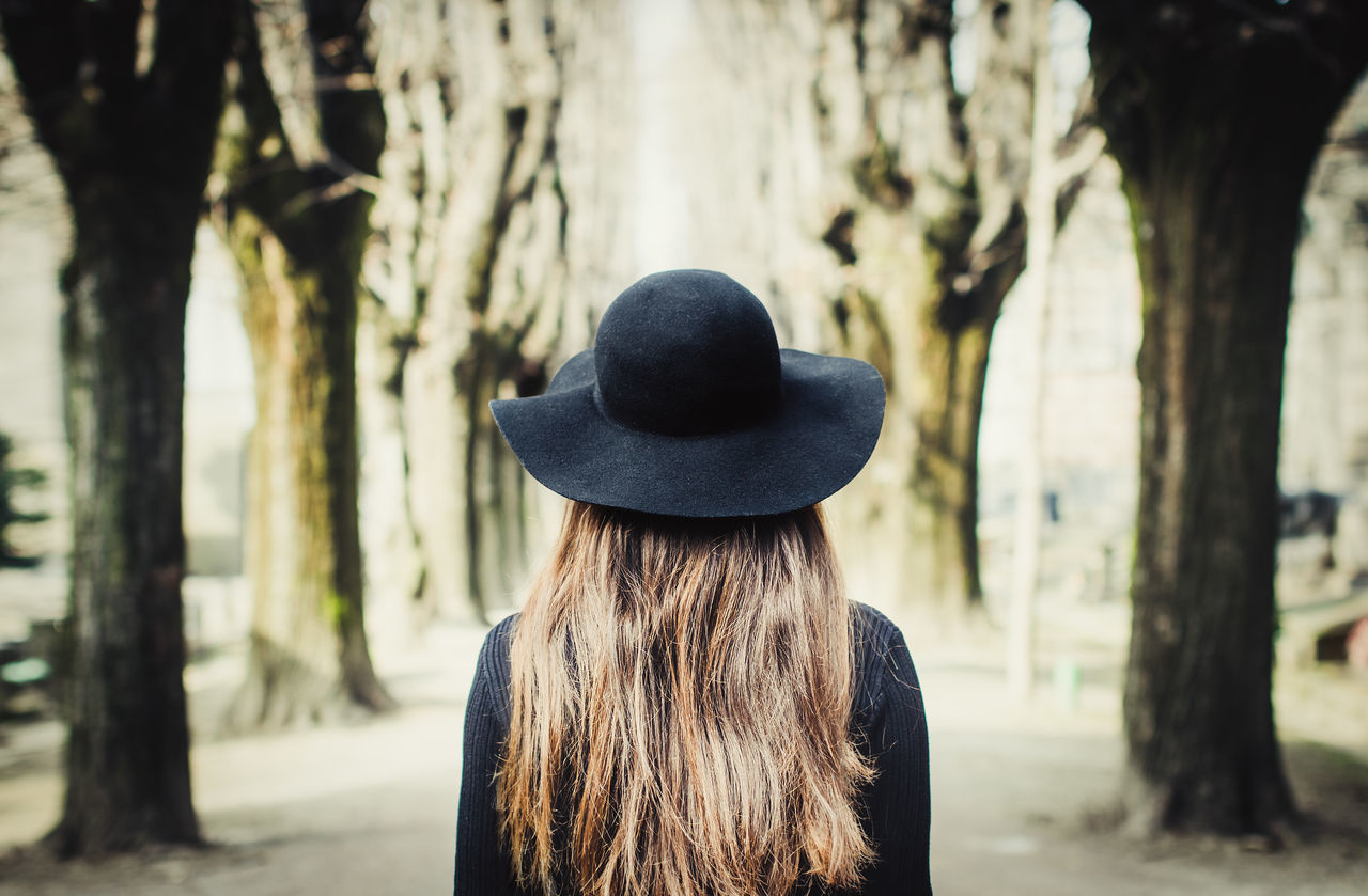black hat , Cimitero Monumentale di Milano Adult Alley Alone Black Day Female Focus On Foreground Girl Hat Headshot Italian Lonely Long Hair Love Milanocity Mystery One Person Outdoors People Real People Rear View Tree Walk Way Young Adult