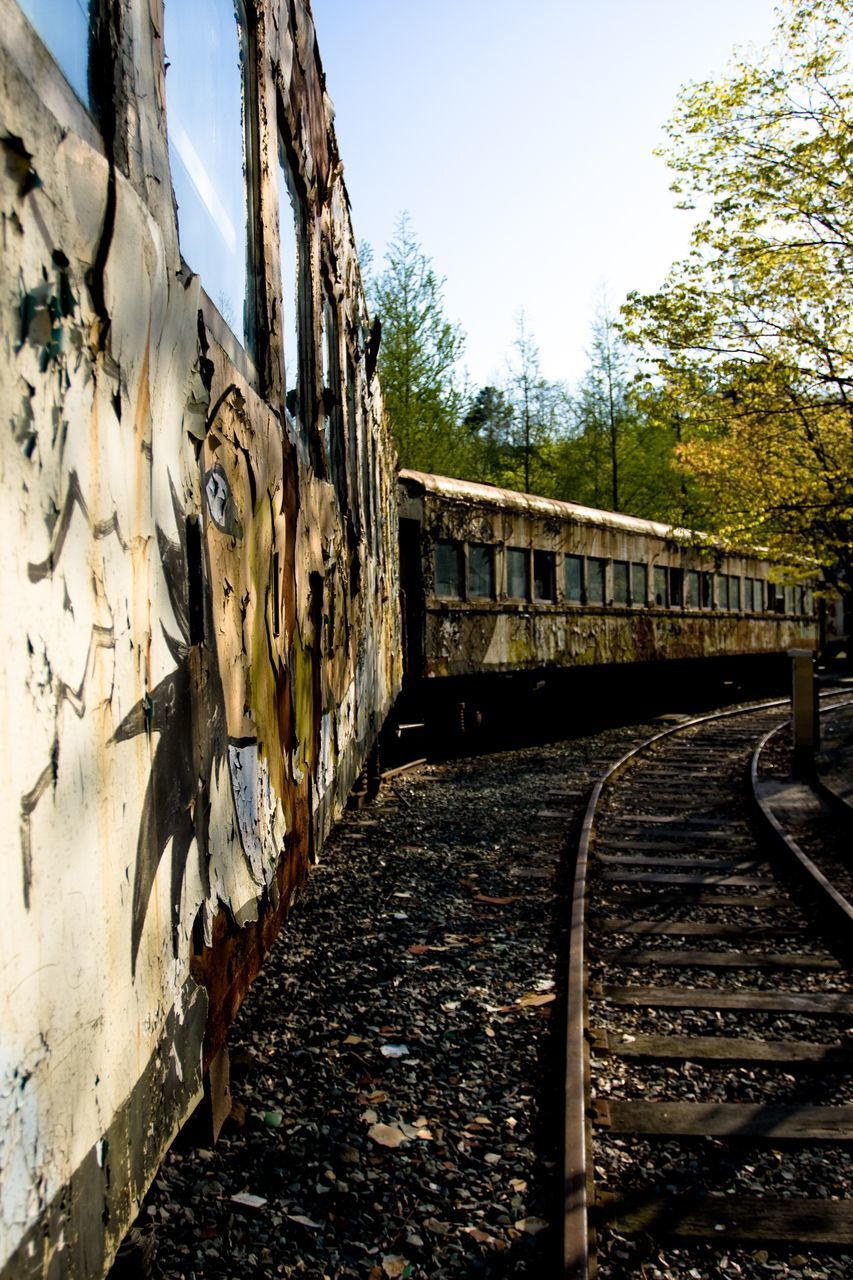 railroad track, rail transportation, transportation, sky, day, train - vehicle, outdoors, no people, tree, architecture
