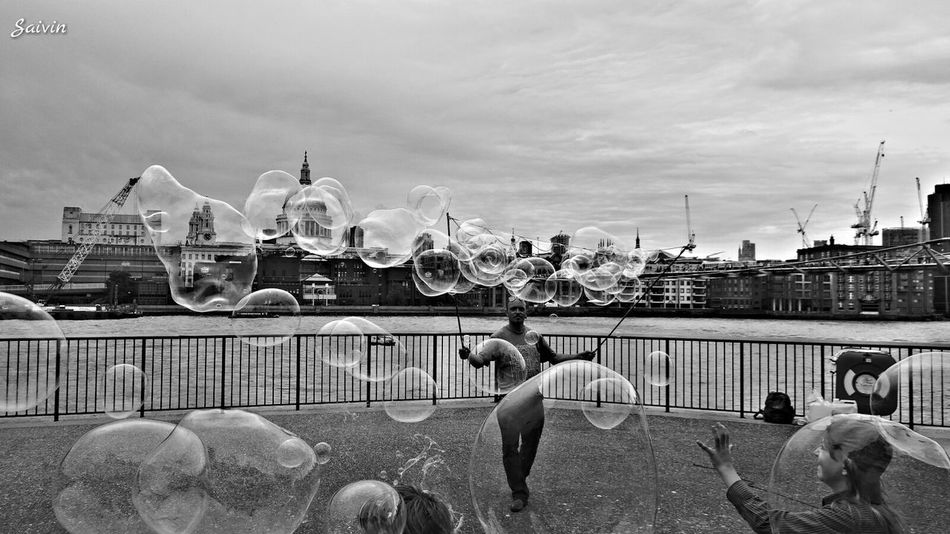 B&w Street Photography B&W Collection Bubbles Playing Playing With Light Street Life Street Photo Street Photography Black And White Ladyphotographerofthemonth The Tourist Photography In Motion People And Places