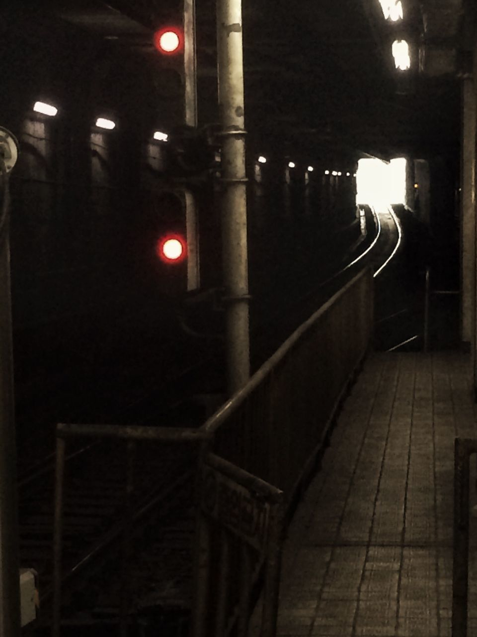 illuminated, night, the way forward, built structure, lighting equipment, architecture, street light, railing, transportation, diminishing perspective, railroad station platform, indoors, empty, railroad station, electric light, railroad track, light - natural phenomenon, building exterior, vanishing point, architectural column