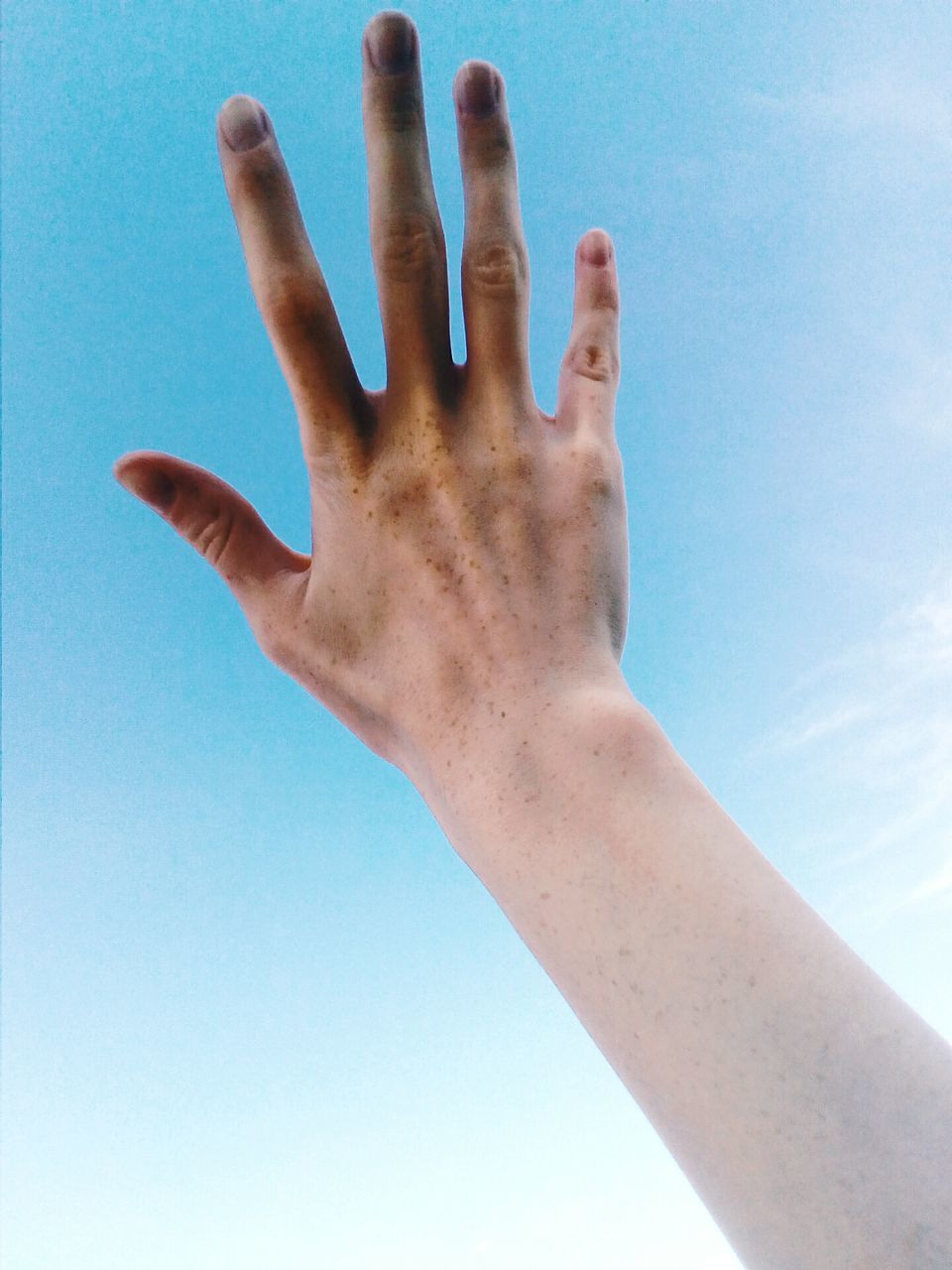 human hand, human finger, human body part, one person, real people, leisure activity, blue, lifestyles, day, sky, low angle view, men, outdoors, women, close-up, palm, people