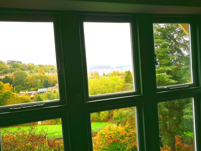 Window Glass - Material Indoors  Looking Through Window Day No People Tree Sky Green Field Autumn Colours Beautiful Cityscape Wooded Hillside Valleys Cotswold Stone Beauty In Nature Nature Outdoors Grass Cloud - Sky Georgian House Posh House Large Fur Tree Window Frame
