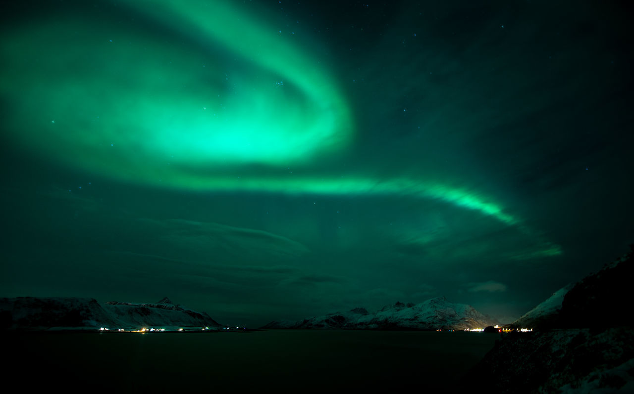 aurora polaris, green color, night, dramatic sky, beauty in nature, nature, illuminated, awe, scenics, sky, tranquility, no people, natural phenomenon, astronomy, outdoors, star - space, water
